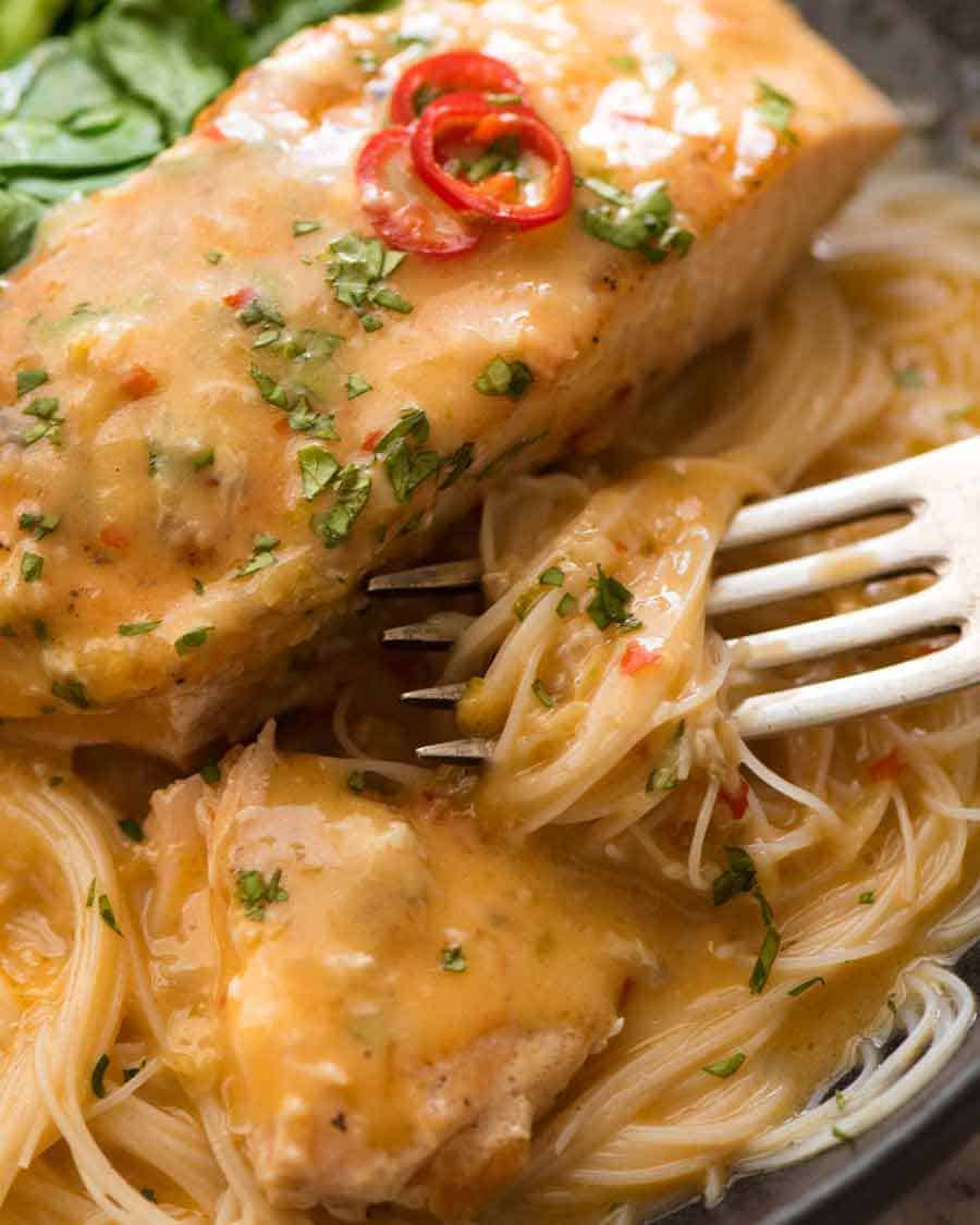 Close up of fork picking up vermicelli noodles smothered in Coconut Lime Sauce